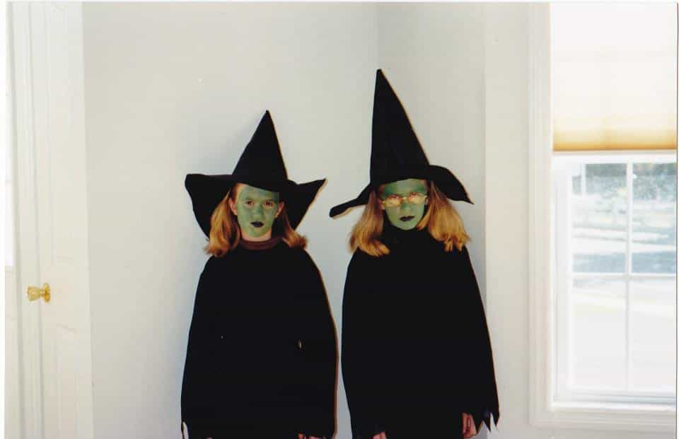Brittany and Janel dressed as witches on Halloween when young