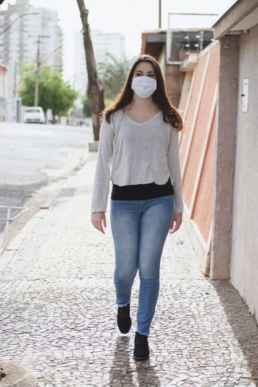 A woman walks around her neighborhood before work