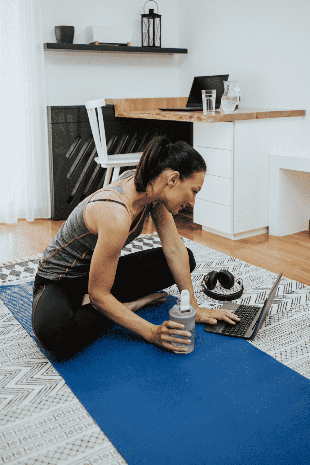 A woman takes a break from remote work to exercise