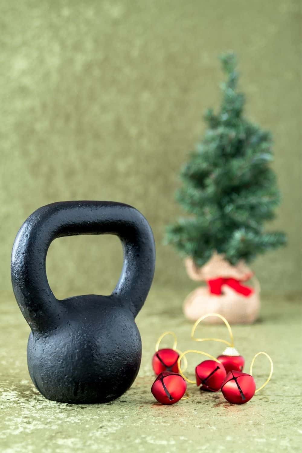 Kettlebell next to a Christmas Tree and Baubles