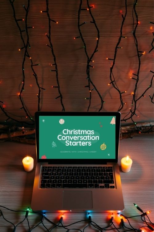 Christmas Conversation Starter Game on a computer in front of Christmas lights