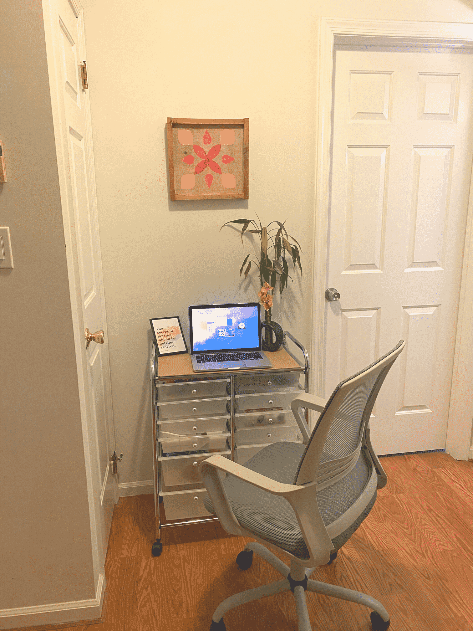 A makeshift desk sits in a hallway