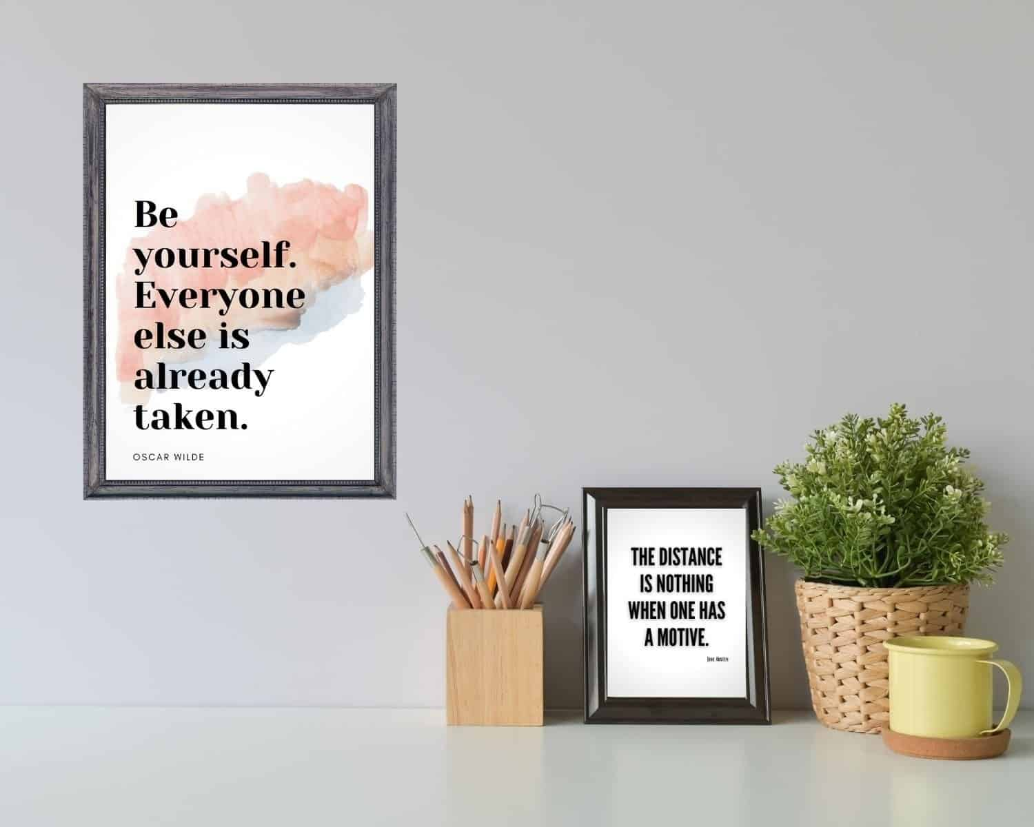Inspirational Quote Art decorates a desk with a plant and mug