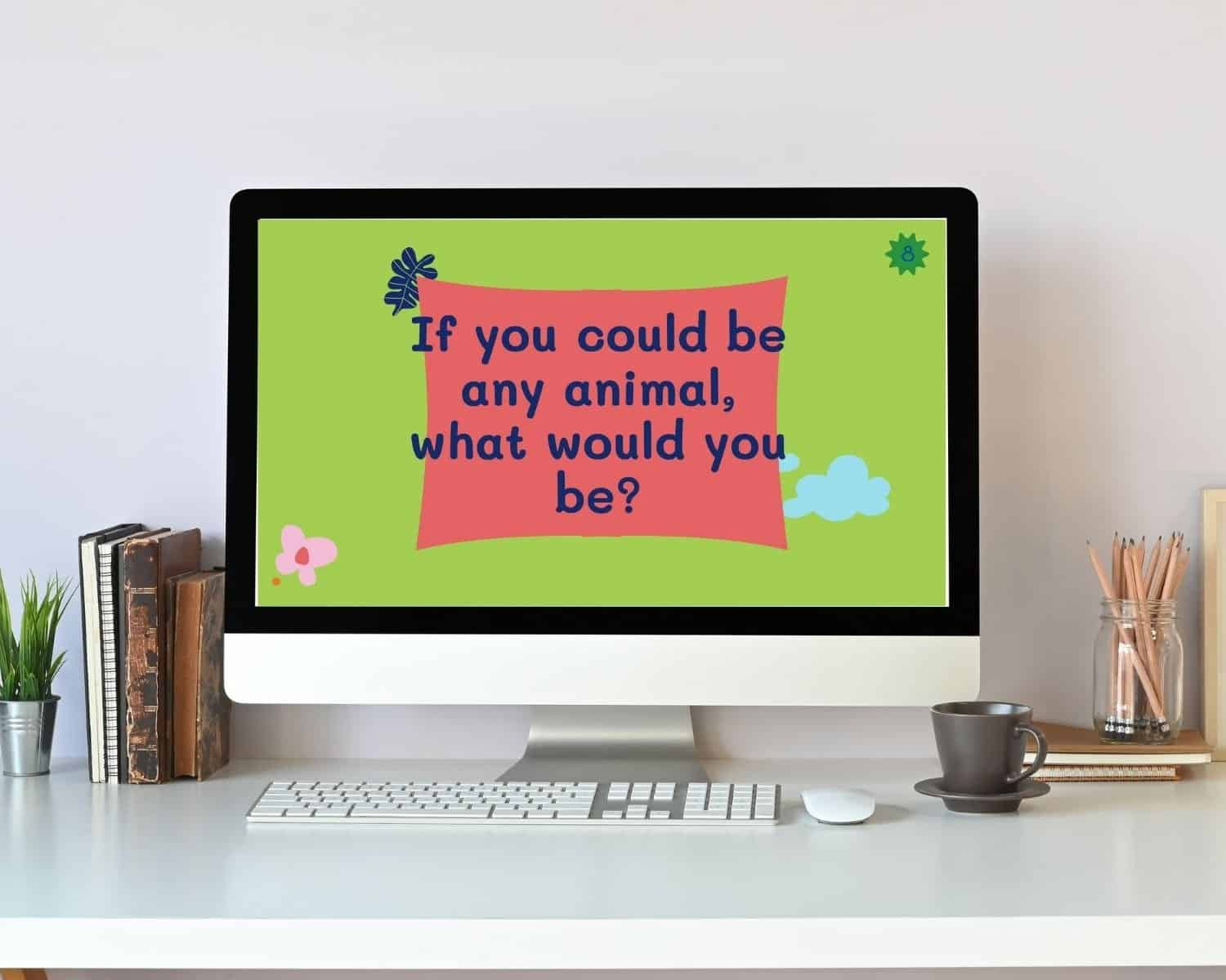 """""""If you could be any animal, what would you be"""" virtual kids' conversation card game question is shown on a computer"""
