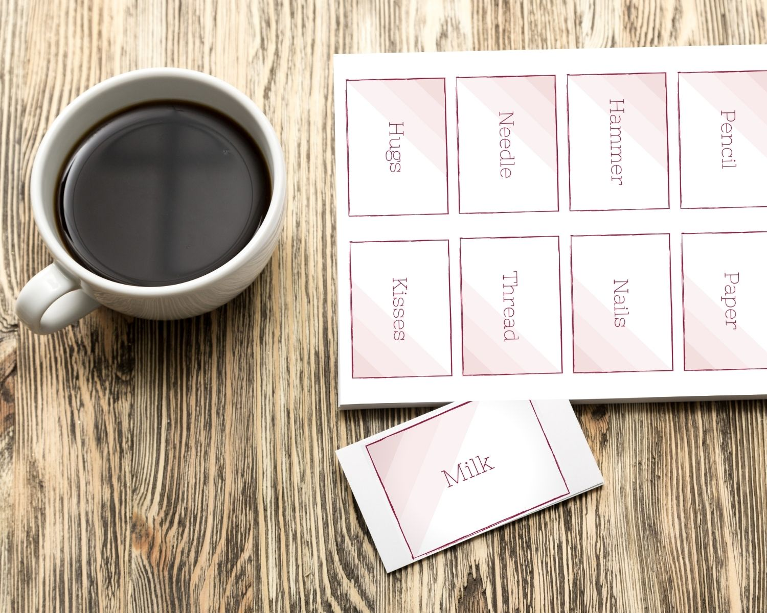 A sheet of find your pair cards sits next to a mug of coffee on a table