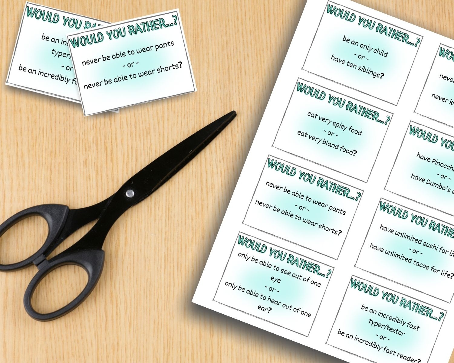 A sheet of would you rather cards sits next to a pair of scissors