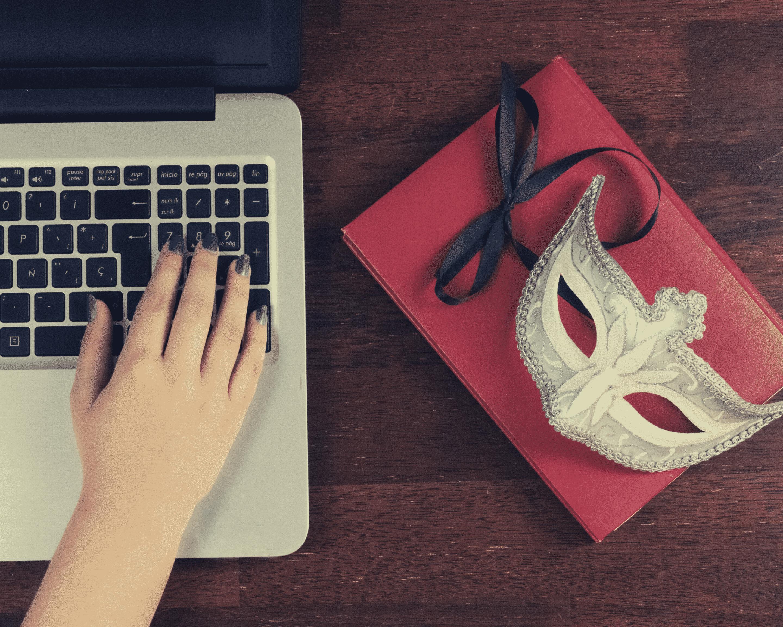 A mask sits next to a laptop